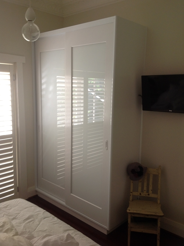 Vinyl wrapped doors with low iron white glass inserts