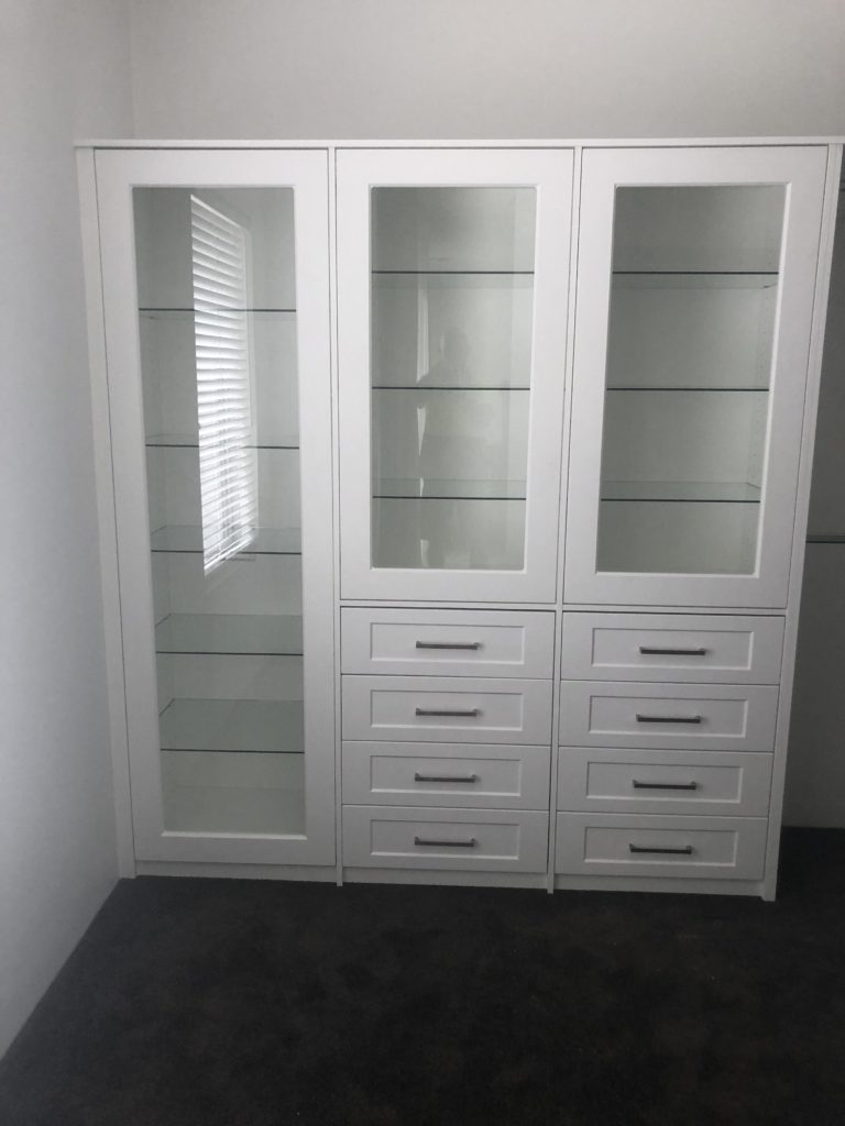 Wardrobe storage unit with glass doors
