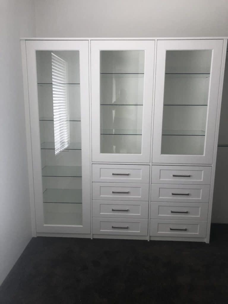 Wardrobe storage unit with glass doors