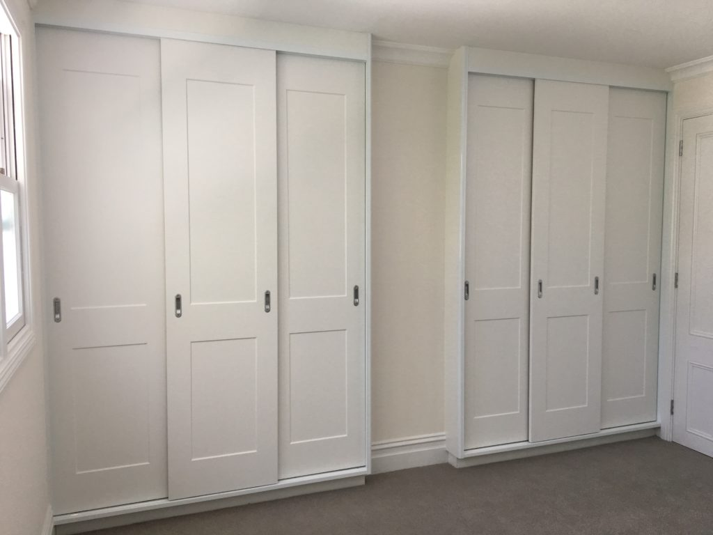 Sliding white vinyl wrapped doors