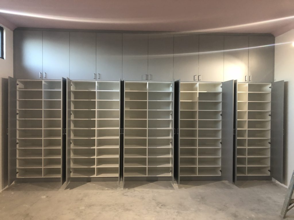 Storage cupboard shelving