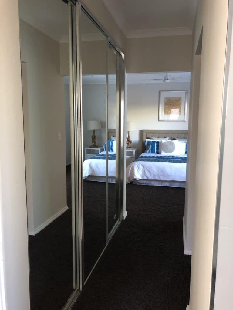 Mirror sliding doors to master bedroom