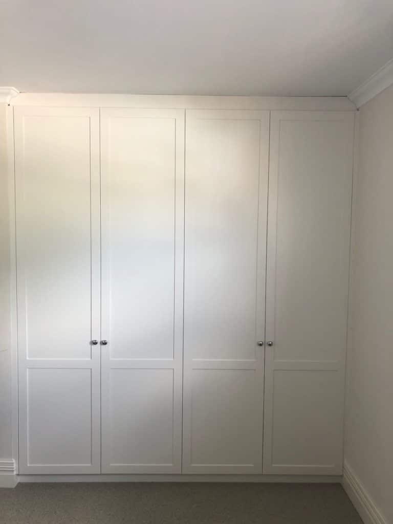 White hinged doors