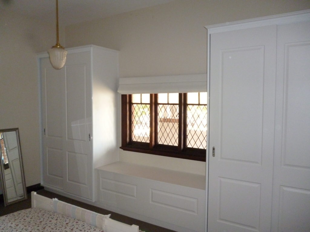Bedroom wardrobes with under window storage seat