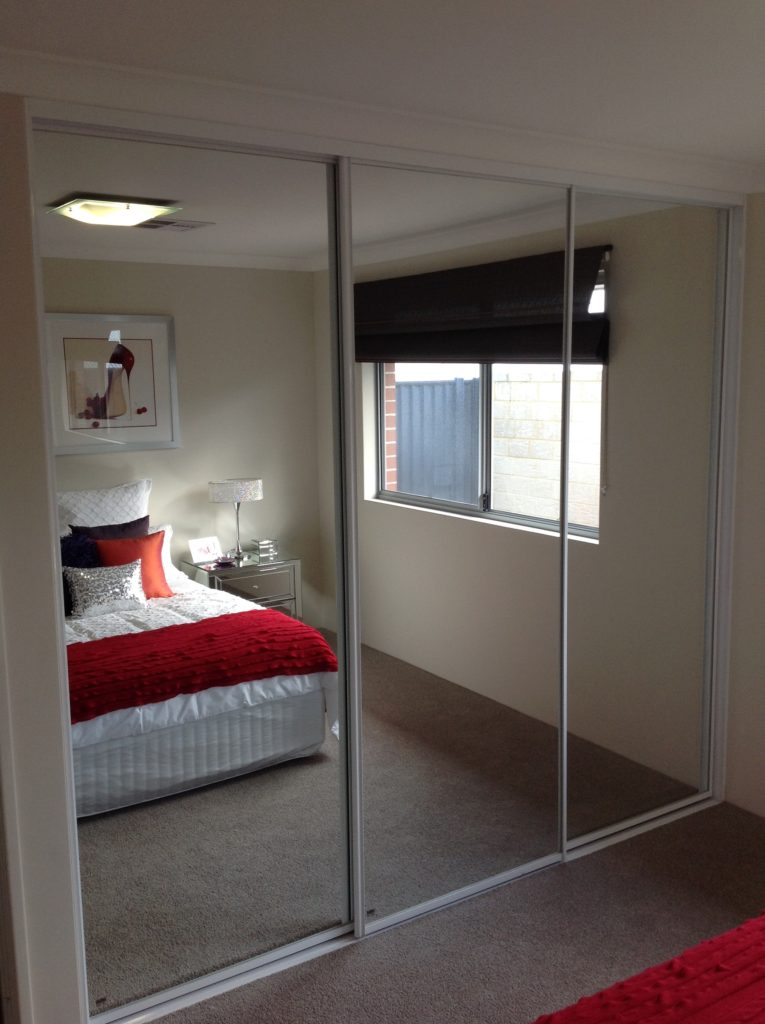 Mirror sliding doors with white frames