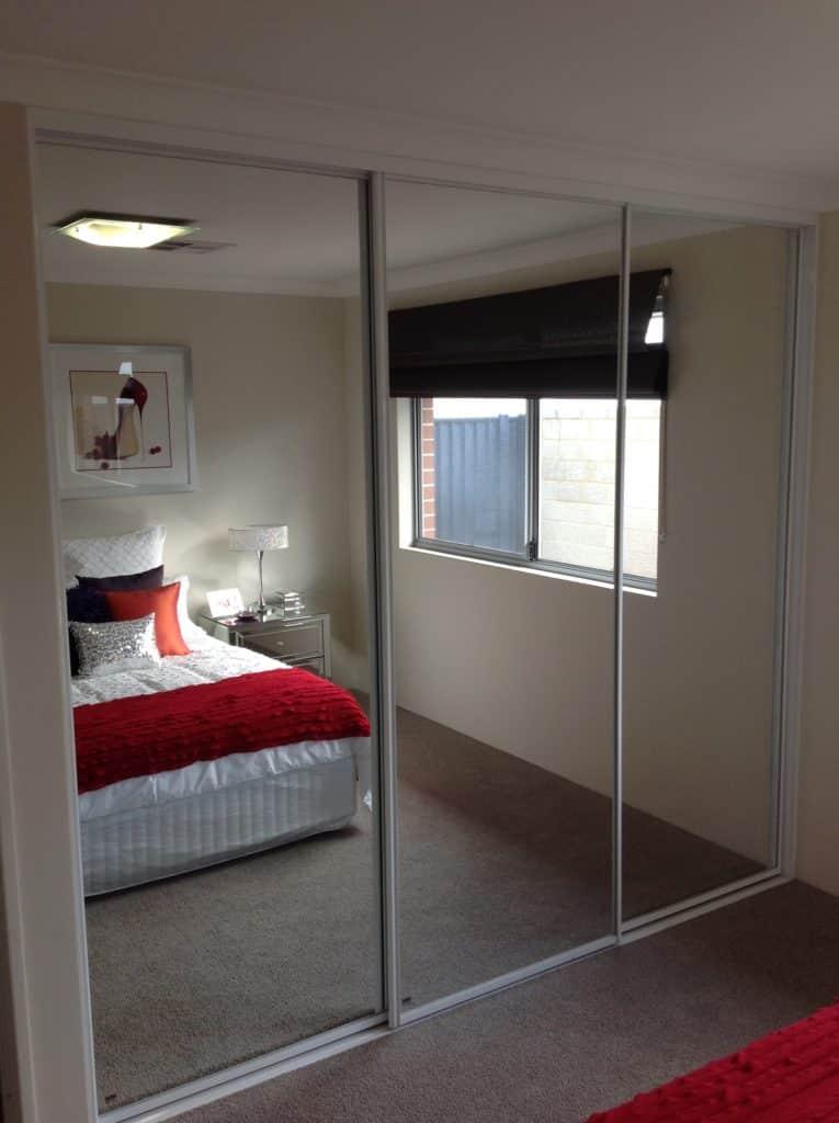 Mirror sliding doors with white frames