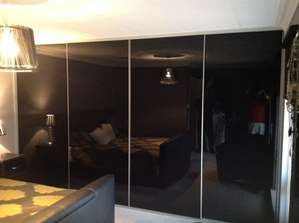 Sliding black glass wardrobe doors
