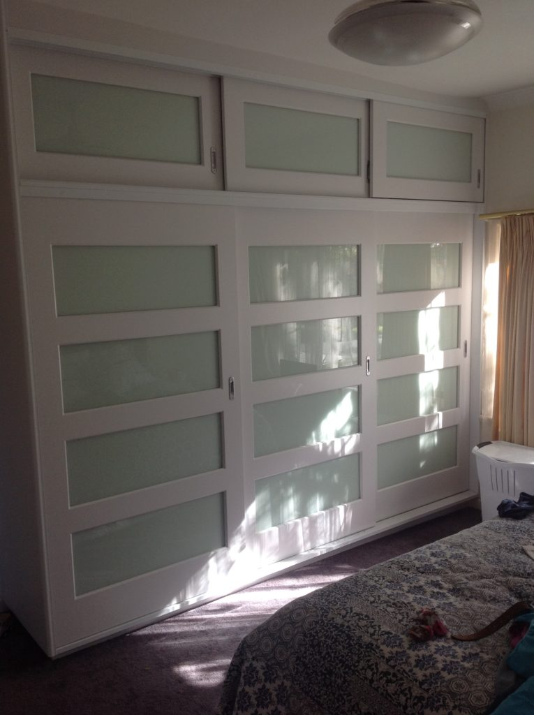 Vinyl doors with glass panels