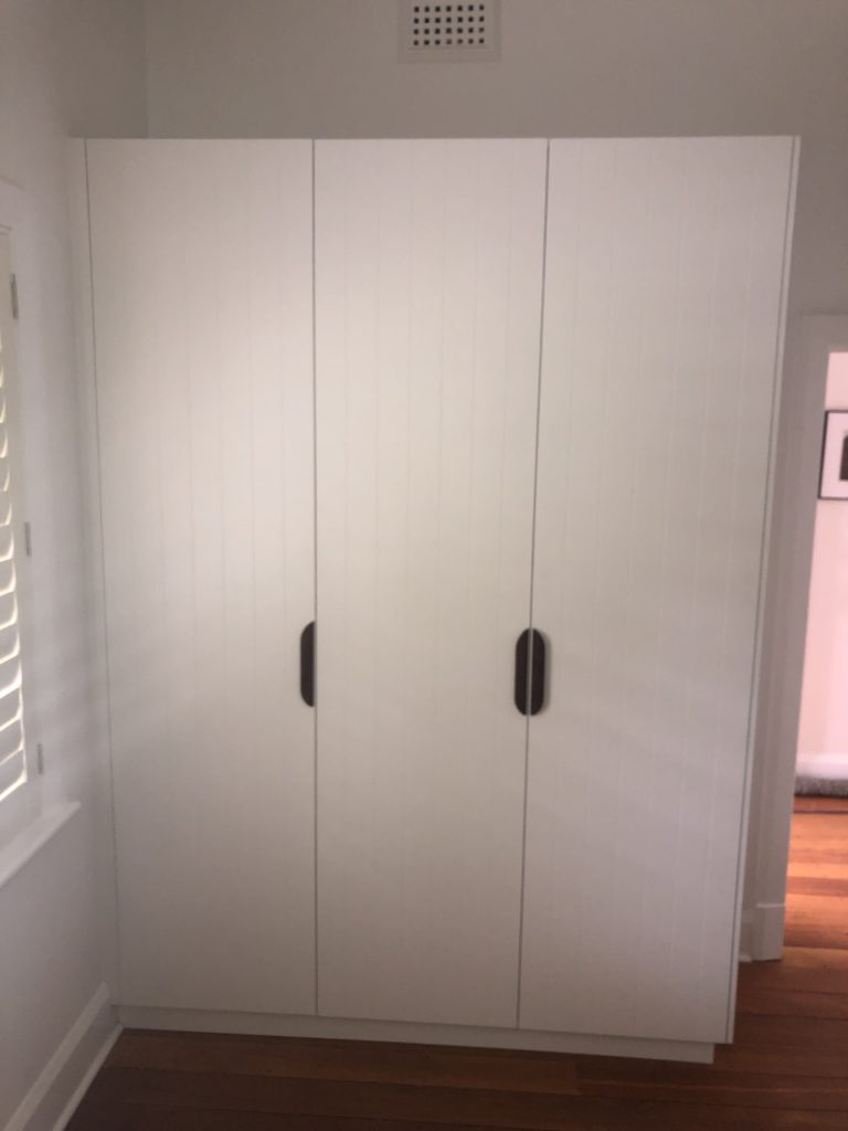 Hinged door wardrobe with black handles