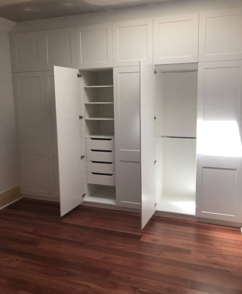 Wall of white wardrobes with internals