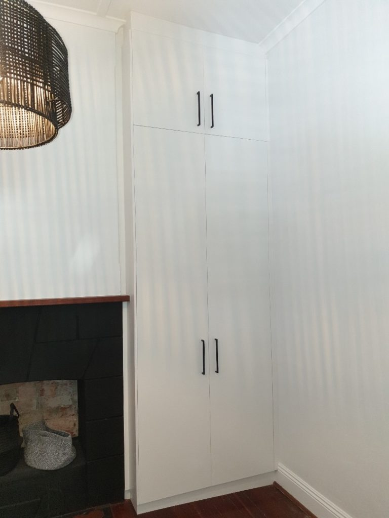 Wardrobe on either side of fireplace