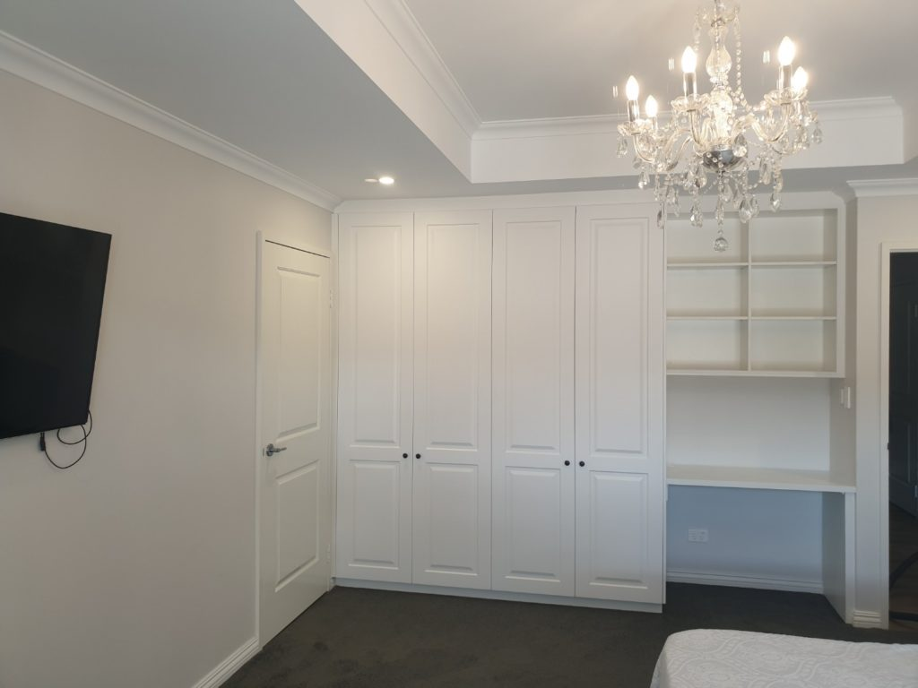 Hinged door wardrobe with desk