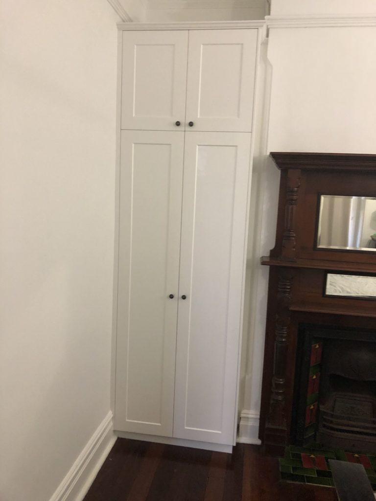 Two tier hinged wardrobe