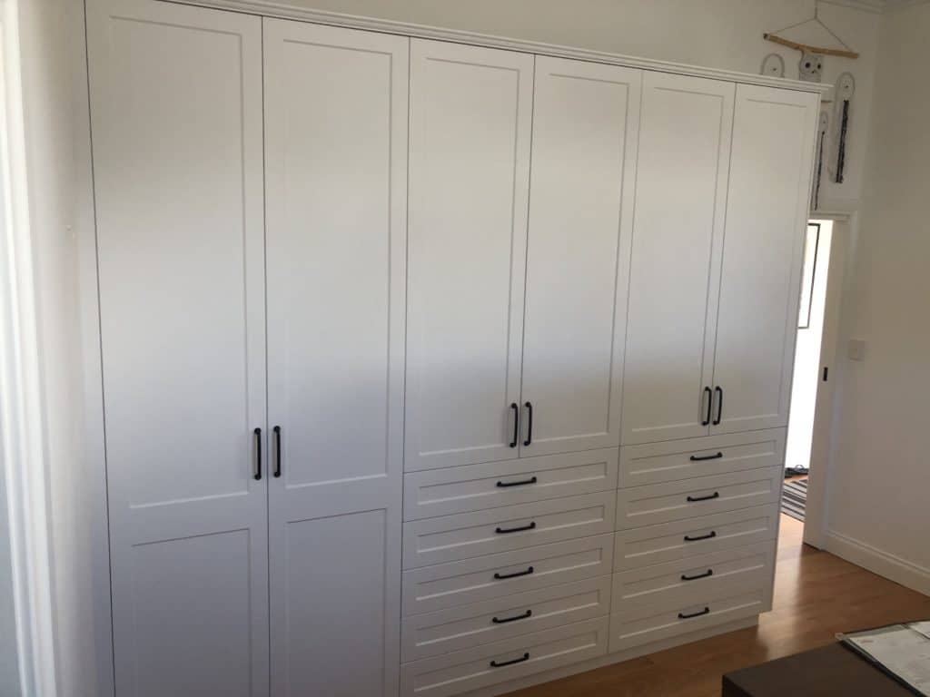 White vinyl wrapped hinged door wardrobe